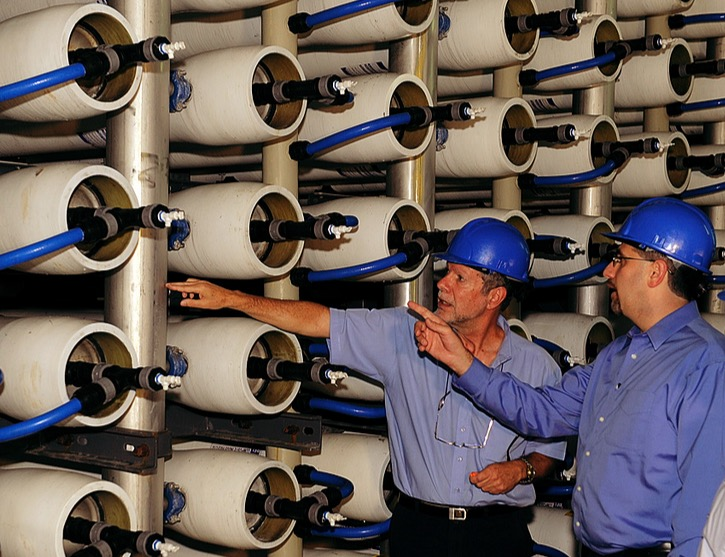 (above) workers inspect an array of reverse osmosis membranes using Israeli technology